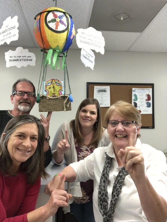 Harrison staff - Danielle, Judy, Sean, and Trish - celebrating 1st place in the Suggestion Box contest.